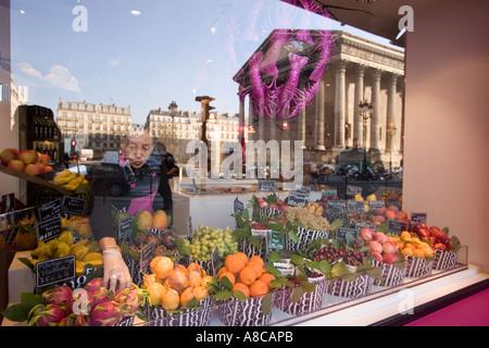 Paris France Place de la Madeleine Fauchon gourmet shop shop window reflection - Stock Image