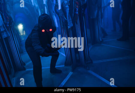 Margate, UK. 13th October 2018. Halloween shocks and scares with actors in costumes at the launch of Screamland at Dreamland in Margate. Credit: Thomas Faull/Alamy Live News - Stock Image