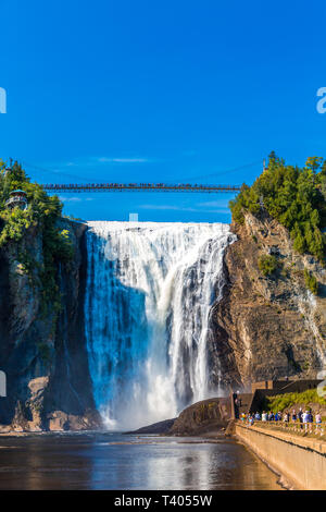 QUEBEC, CANADA - September 16, 2018: The Montmorency Falls is a waterfall on the Montmorency River in Quebec, Canada. The many tourists that visit the - Stock Image