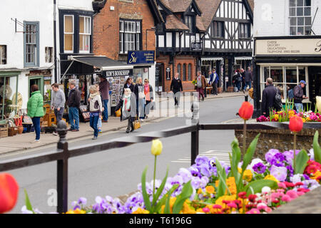 Shoppers in the old High Street, Arundel, West Sussex, England, UK, Britain - Stock Image
