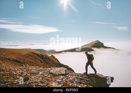 Man hiking alone in mountains active summer vacations adventure travel lifestyle journey outdoor in Norway - Stock Image
