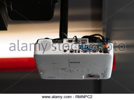 Poznan, Poland - February 2, 2019: Epson projector attached on a ceiling in a university room. - Stock Image