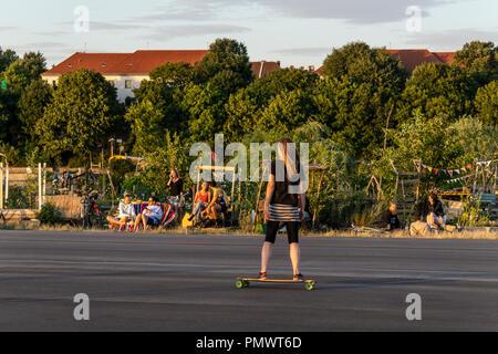 Tempelhofer Feld, roller scater at former airport area Tempelhof, urban garden, alternative scene, Berlin - Stock Image