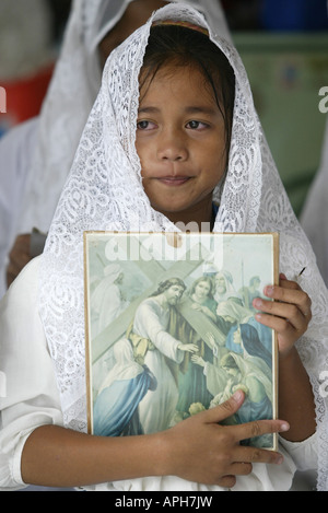 A Filipina participates in a portrayal of Christ's passion at a Catholic Church in Mansalay, Oriental Mindoro, - Stock Image