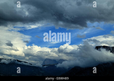 Dynamic clouds in the Alps - Stock Image