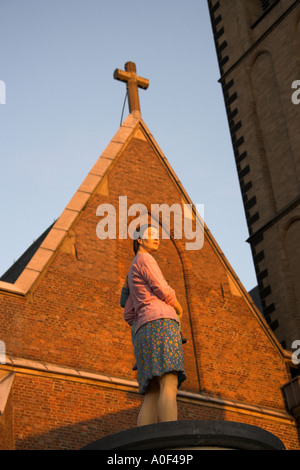 Statue of a Woman in Front of St Lambertus Church River Rhine Dusseldorf Germany - Stock Image