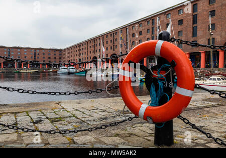 A red and white lifebelt with the the Albert Dock Liverpool in the background May 2018 - Stock Image