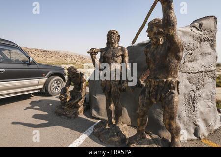 Azerbaijan, Gobustan, Gobustan Rock Art Cultural Landscape, UNESCO World Heritage Site; statues at entry - Stock Image