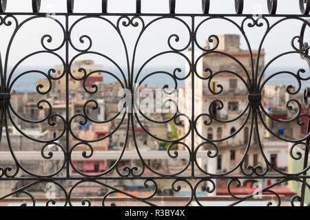 Cuba, Havana. Late afternoon rainbow and city viewed through wrought iron railing. Credit as: Wendy Kaveney / Jaynes Gallery / DanitaDelimont.com - Stock Image