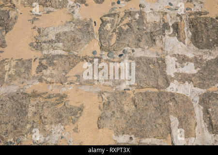Texture of paved rock and sand at St Annes on Sea Fylde Coast February 2019 - Stock Image