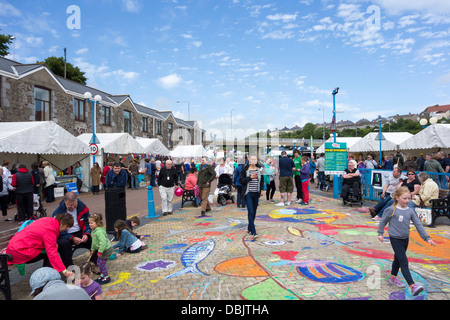 Stalls and visitors at the annual Pembrokeshire Fish Week festival at Milford Haven, Pembrokeshire. - Stock Image