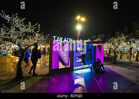 Neon sigh near the Bangkok night market in Nana plaza, Thailand - Stock Image