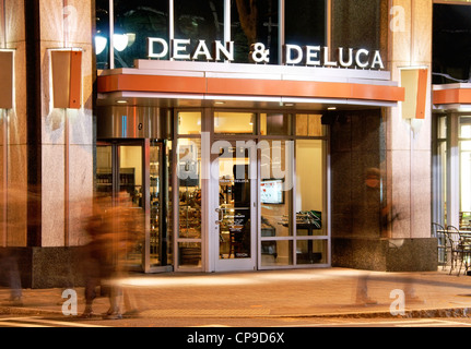 Dean and Deluca gourmet food store in downtown Charlotte, NC, North Carolina, at night. - Stock Image