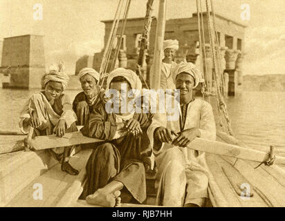 Berberin boatmen rowing a galley, near the island of Philae, Egypt. - Stock Image