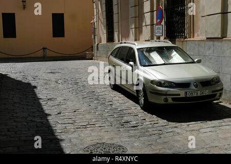 A car with a silver screen to reflect the sun in Spain - Stock Image