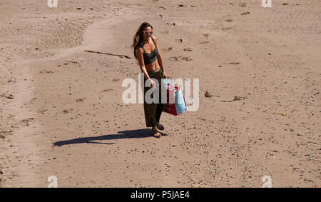 Dundee, Tayside, Scotland, UK. 27th June, 2018. UK weather: A woman walking along Broughty Ferry beach in Dundee enjoying the hot sunny weather with temperatures reaching 20º Celsius. Credits: Dundee Photographics / Alamy Live News - Stock Image