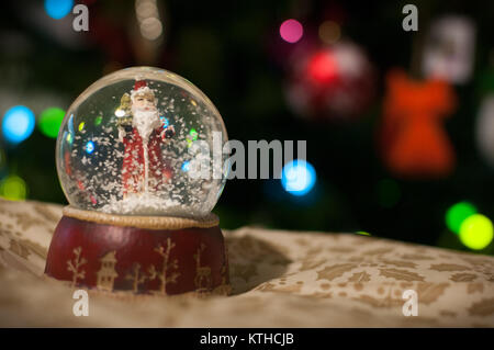 A Crystal Ball With Santa Claus Inside - Stock Image