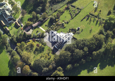 Aerial view of detached house with formal gardens - Stock Image