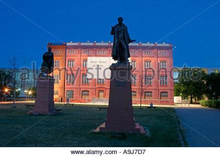 Berlin Schinkel Bauakademie show fassade of former construction academie by Schinkel statue - Stock Image