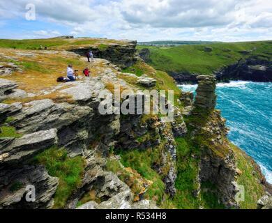 Tourists taking photographs,Tintagel castle Island Peninsula,Cornwall,England,UK - Stock Image