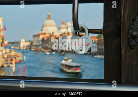 Heart shaped love lock on a bridge in Venice Italy - Stock Image
