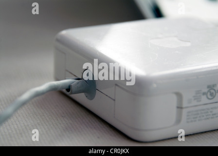 Apple MacBook Pro faulty T MagSafe power adapter MacBook fray frayed Mag Safe adapters cord cords separation between - Stock Image