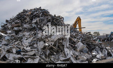 A large pile of used waste stainless steel waiting to be crushed and sent for recycling - Stock Image