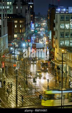 Manchester city centre Oxford Street junction with St Peters Square crossed by a Metrolink tram at night - Stock Image