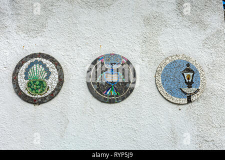 Decorative mosaic roundels on a wall, High Street, South Queensferry, Edinburgh, Scotland, UK - Stock Image