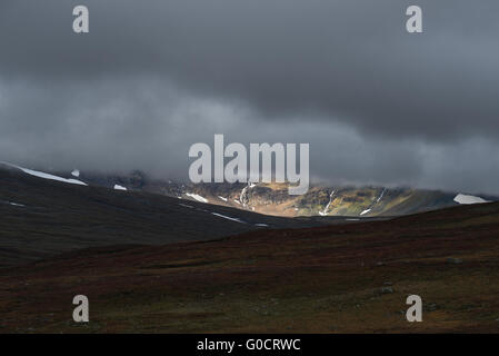 Distant mountain emerges from thick clouds, Kungsleden trail, Lapland, Sweden - Stock Image