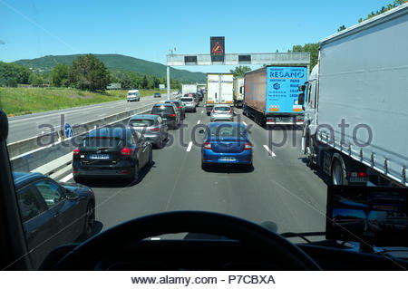 Lorry driver's view of heavy traffic congestion on the A7 autoroute (north), near Montélimar in southern France. - Stock Image