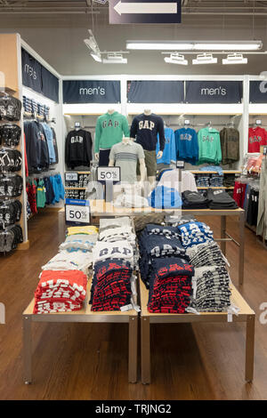 The men's section of the GAP store at the Tanger Outlets in Deer Park, Long Island, New York. - Stock Image