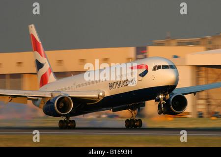 British Airways Boeing 767 touching down at London Heathrow Airport United Kingdom - Stock Image