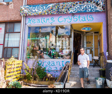 Man comes out of the Healing Crystals store in Kensington Market in downtown Toronto Ontario Canada - Stock Image