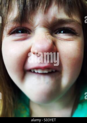 Silly Caucasian smiling goofy face girl - Stock Image