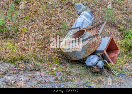 Industrial metal scrap machinery dumped by roadside - Stock Image
