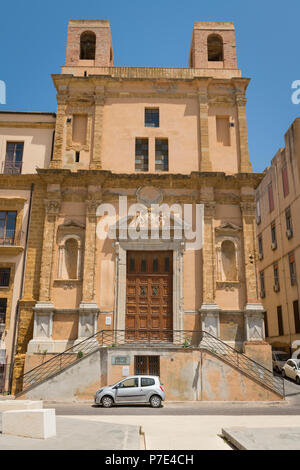Italy Sicily Agrigento Piazza Chiesa S San Giuseppe St Saint Church bell towers stairs steps closed wooden doors ornate Baroque portal parked cars - Stock Image