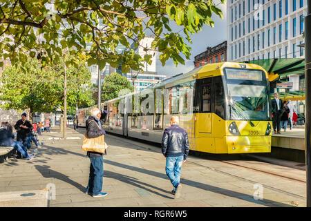 2 November 2018: Manchester, UK - Metrolink tram in St Peter's Square in the autumn sunshine. - Stock Image
