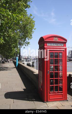 English red telephone box Victoria Embankment London - Stock Image