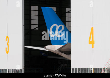 Airplane tail with Air Europa logo in a hangar during maintenance - Stock Image