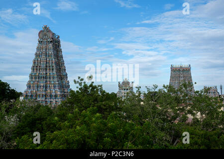 Several of the fourteen 'gopura' (gateway towers) of Meenakshi Amman Temple, Madurai, Tamil Nadu, India. - Stock Image