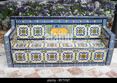 Old La Sucha tobacco advertising slogan on ceramic tiled bench in the  Plaza de Los Patos in Santa Cruz de Tenerife, Tenerife, Canary Islands - Stock Image