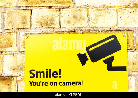 Smile you're on camera sign, Smile you're on camera CCTV sign, CCTV sign, CCTV, warning, Smile! sign, camera, big brother watching, big brother, UK - Stock Image
