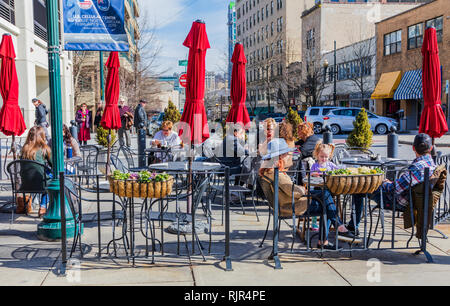 ASHEVILLE, NC, USA-2/3/19: Seating on the sidewalk in front of Carmel's Kitchen & Bar on Page St., on a warm, sunny winter day. - Stock Image