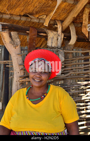 Shakaland Zulu lady troupe member poses in a traditional  Zulu hat at the  Shakaland Cultural Village - Stock Image