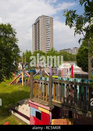 Michael Cliffe House, Skinner Street, Finsbury Estate, Clerkenwell, Islington, London, 2005-2007. General view looking north-east across the Three Corners adventure playground towards the 25-storey block of flats completed in 1968. - Stock Image