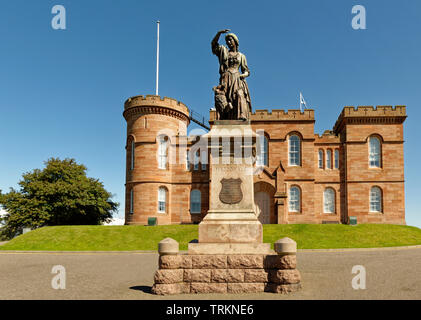 INVERNESS CITY SCOTLAND CENTRAL CITY FLORA MACDONALD STATUE IN FRONT OF THE RED STONE CASTLE - Stock Image