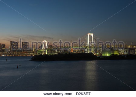 Tokyo city skyline and the Rainbow Bridge from Odaiba Tokyo Japan - Stock Image