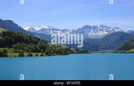 Lake Lungeren and mountain range. Early summer in Switzerland. - Stock Image