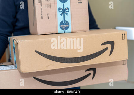 PARIS, FRANCE - DECEMBER 16, 2018: An Amazon Prime package delivered to a residential home - Stock Image